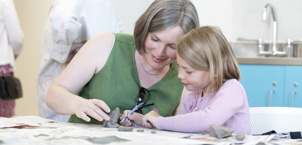 A lady and daughter doing craft activity.