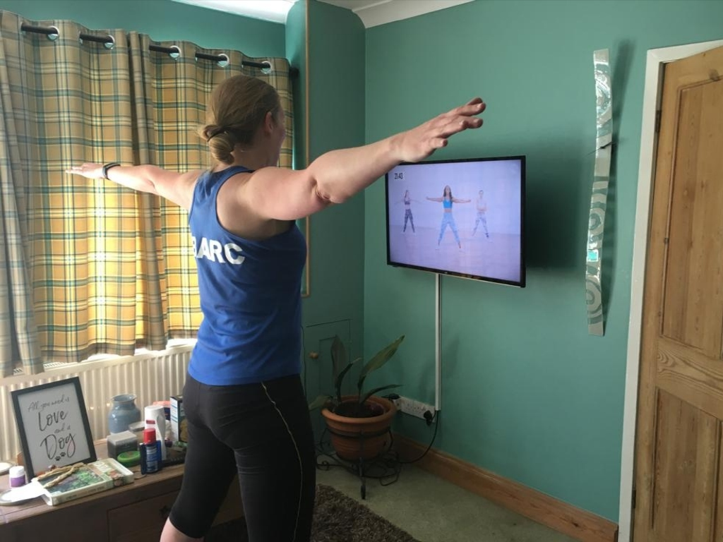 Woman following a workout video