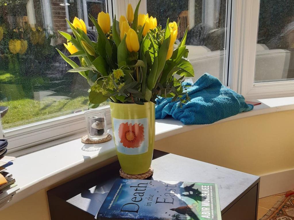 Vase of yellow tulips