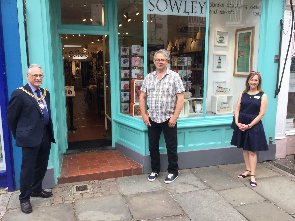 Lord Mayor standing outside Canterbury shop with owner