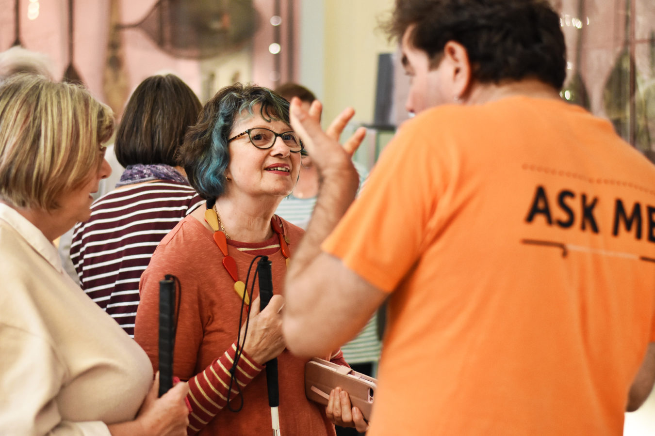 Two visitors chatting to a member of staff in the Explorers and Collectors Gallery.