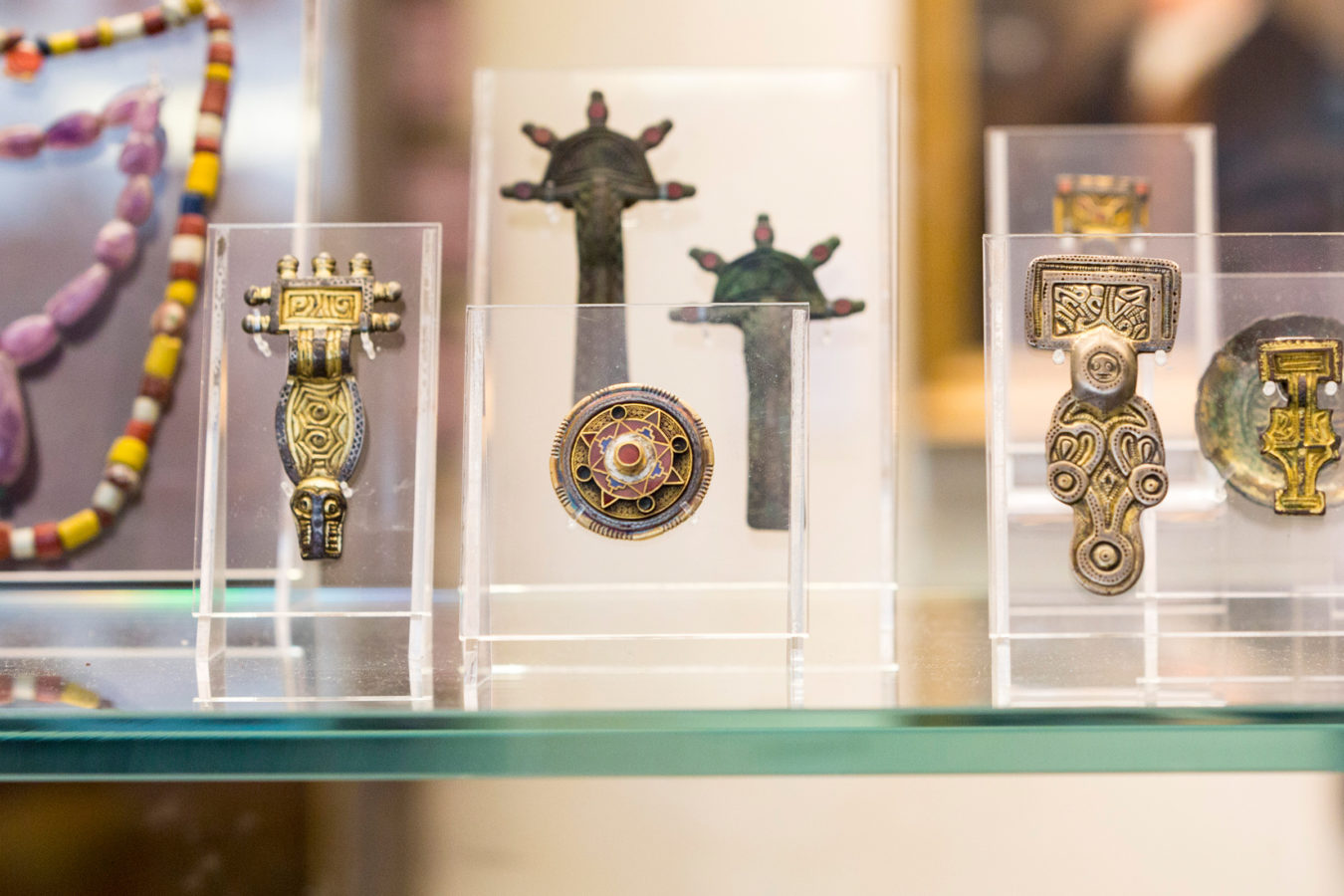Jewellery artefacts on display in a cabinet in The Explorers and Collectors Gallery.