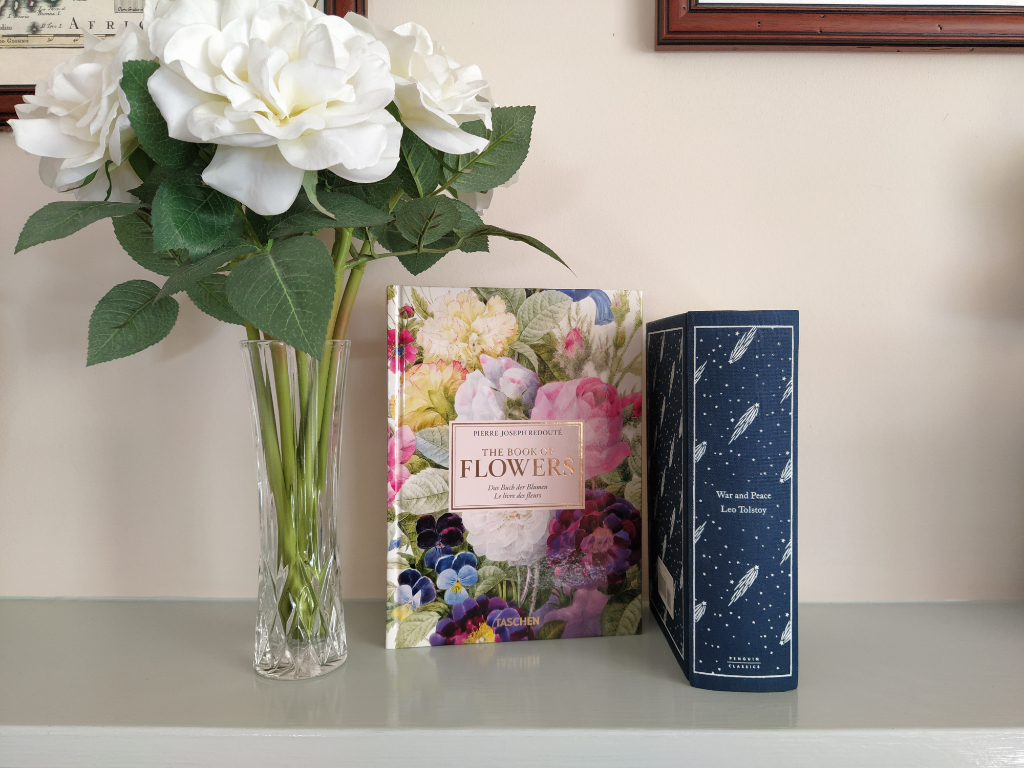 Flowers in a vase next to books