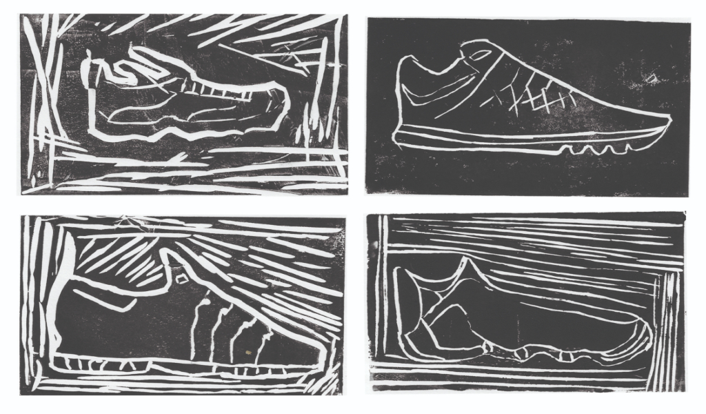Black and white linocut print of 4 trainer shoes