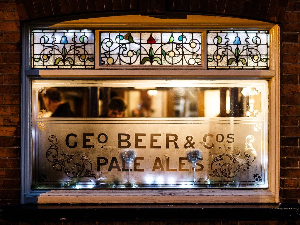 Pub window at night